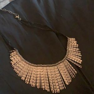 This is a Handcrafted neckpiece and earrings